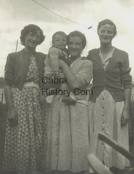 Marie Whelan Lower Carnlough Rd holding sister Josie with two friends
