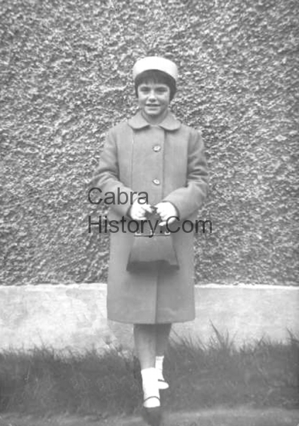 Mary Brogan from Carnlough Road making her Confirmation 7th March 1967