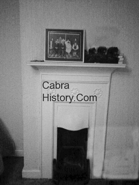 The old fireplace in the front bedroom of Cabra houses