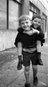 Little boy carrying his pal